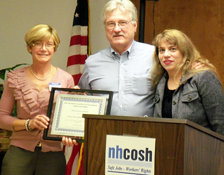At this year?s annual members dinner meeting, the newly elected NH COSH Executive Board Chair, Louise Anne Hannan [on the right] awards new board member, Karla Armenti, [on the left] the NH COSH Achievement Award for her continued oversight of occupational health surveillance in New Hampshire with them is Dennis Martino [center] who stepped down as board chair after many years of service.